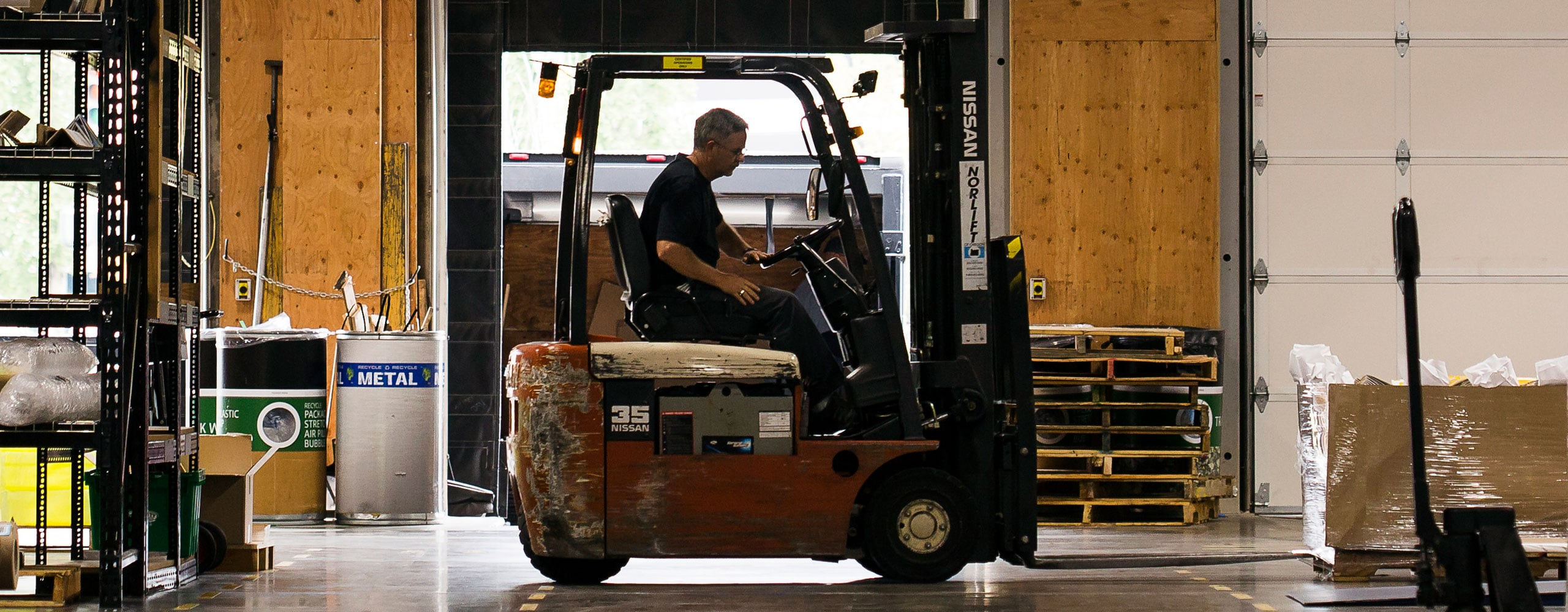 A forklift moves product around the shop at Premier Press